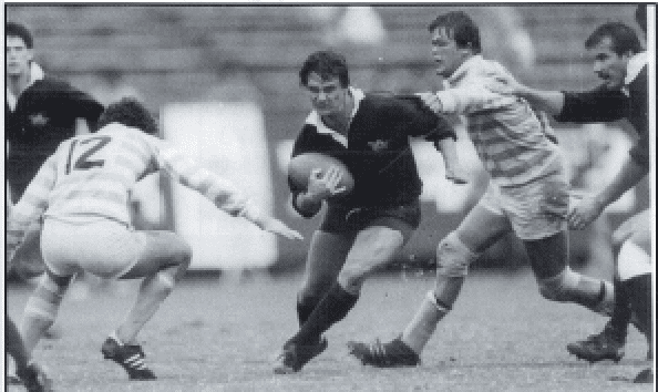 Reg Clark make a break for Oxford in Varisty match in Tokyo in 1983